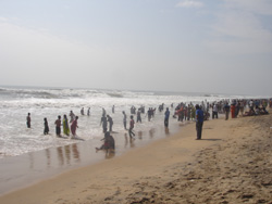 Devotees taking bath at Puri Beach